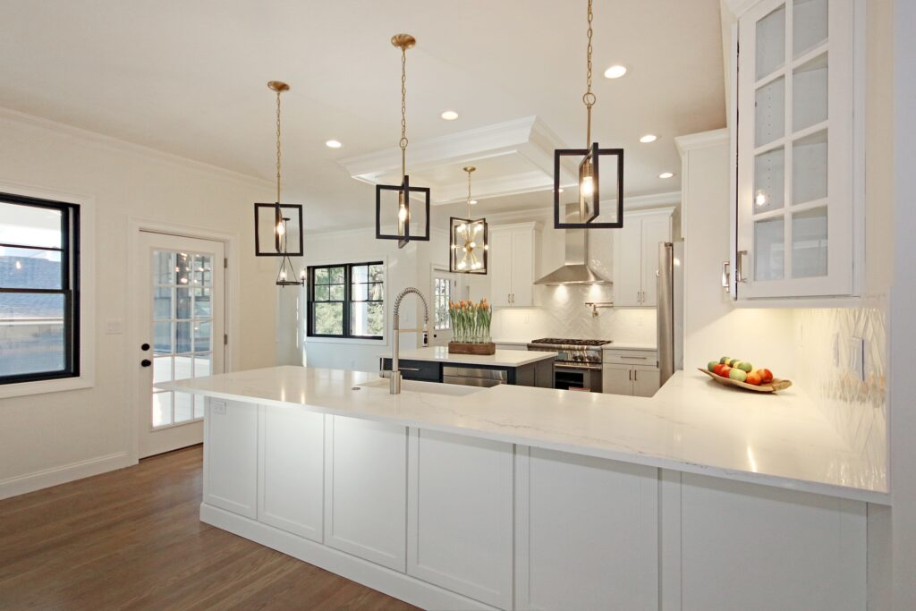 Classic kitchen created with clean white Homecrest cabinets