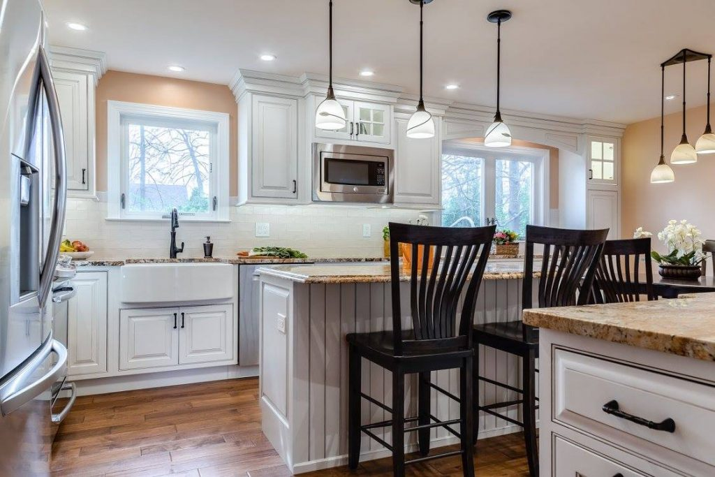Starmark kitchen designsCustom made kitchen created with Starmark paneled cabinets created to give the warm and inviting farmhouse feeling