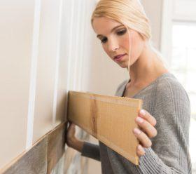 woman installing ARTIS wall