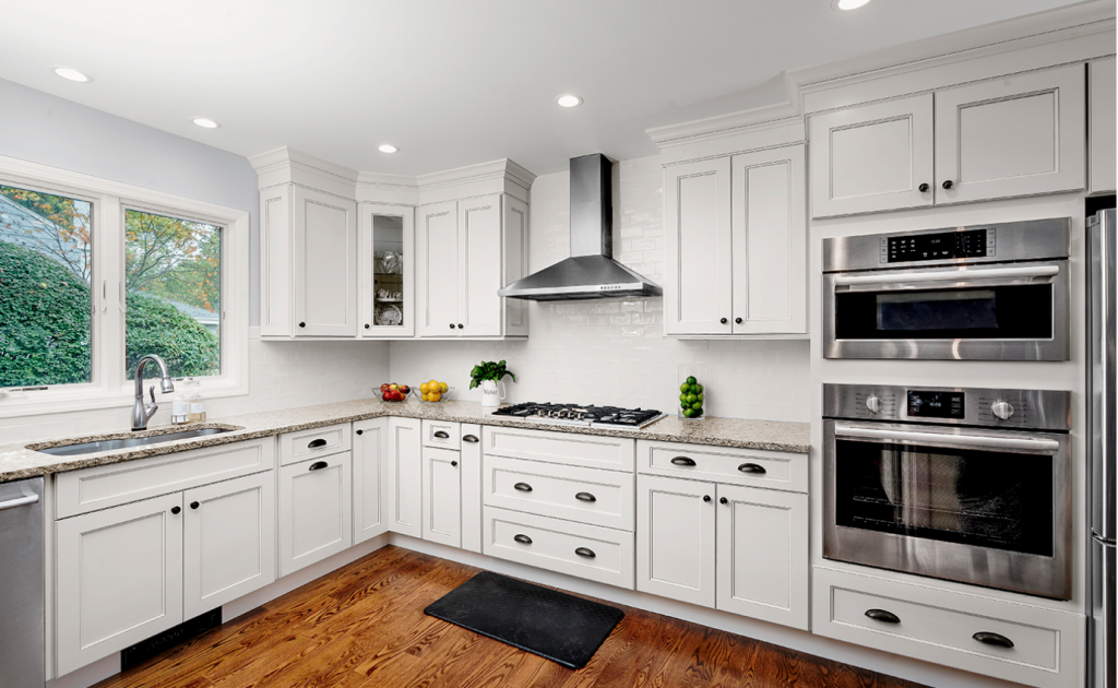 White custom kitchen cabinets designed with Fabuwood cabinets, with stainless steel accents, giving it a look that never fails to please