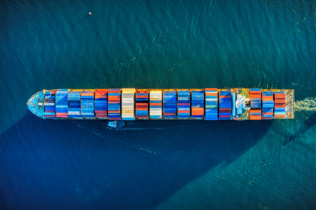 Freighter Ship With Cargo Containers Transporting Building Products