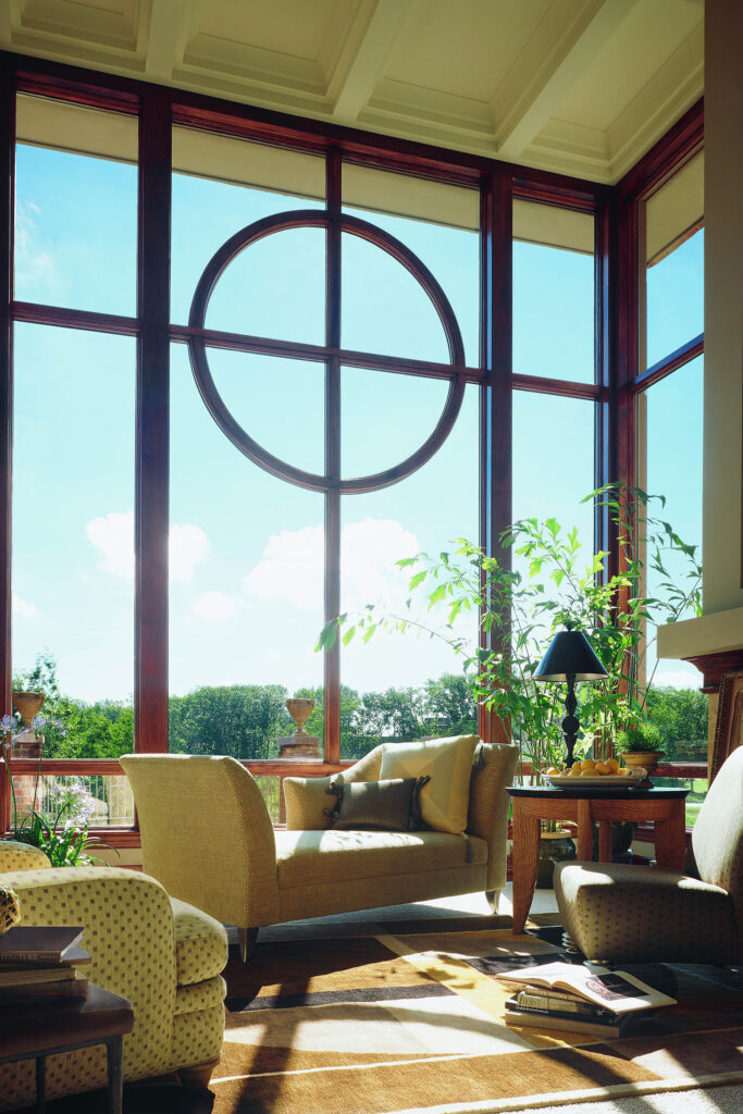 Bright Living Room With Floor-to-ceiling Combination of 400 Series Flexiframe® Specialty Fixed Windows