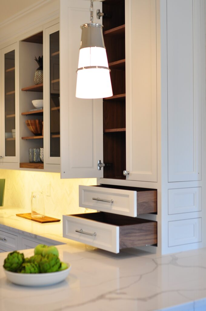 Custom designed upper kitchen cabinets with drawers