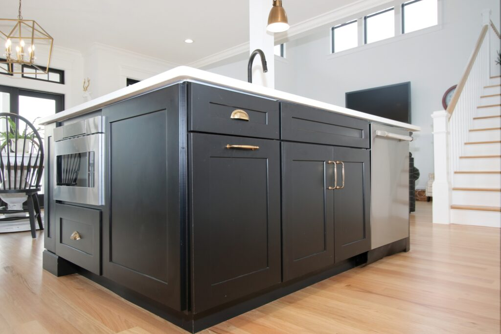 Charcoal gray kitchen island with custom kitchen cabinet