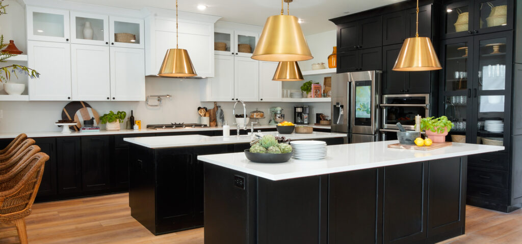Black and white custom designed kitchen with brass accents by Starmark